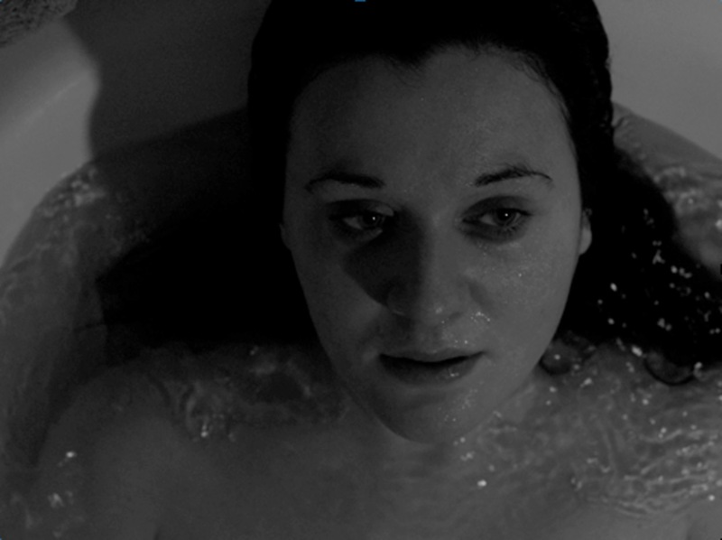 Still from Dead Instant Photo short film directed by giuliensemble. Actress Sarah Barberis in the bathtub.