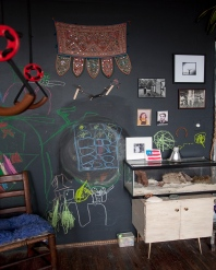 The living room of the Sherman family. Tara Sansone and Hil Sherman moved into the buildng as a young couple in 2000. The wall-size board is used for drawing by their children Mela and Marcello. Mela nad Marcello are the keepers of the Hermit Crab contained in the tank. October 2012.